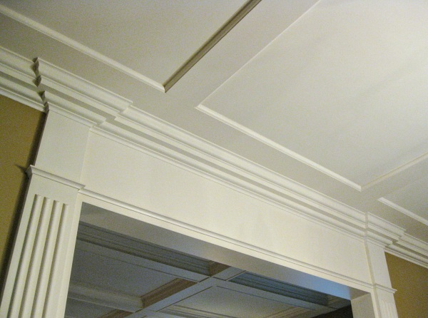 My favorite view of the completed project: I like how the molding wraps around the columns; the faux beams and my coffered ceiling project in the background.