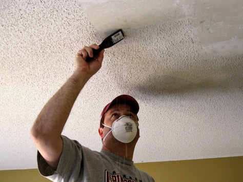 The process: mist the ceiling with a spray bottle and then scrape the texture off.
