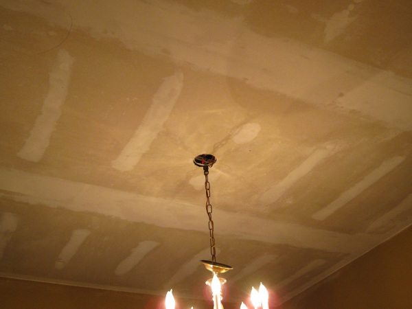 After scraping and sanding, the ceiling looks like this.