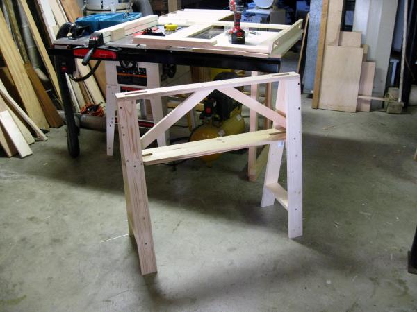 Note the second saw horse coming together on top of my table saw.