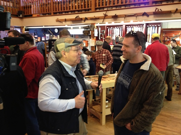 Chris Adkins of Modern Woodworkers Association gets his turn with Charles Brock.