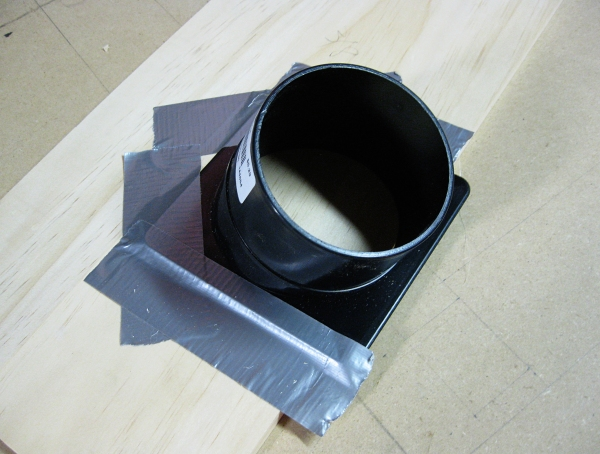 Making a template - the dust port taped to some template stock.