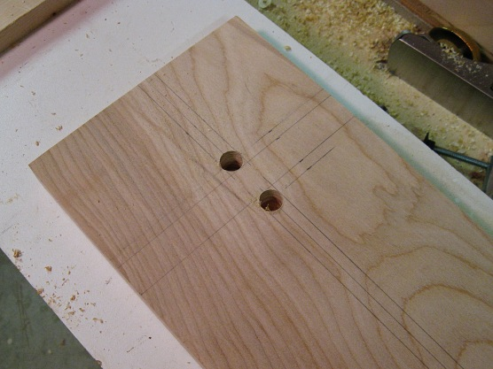 Carefully cut half-inch holes.