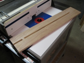 The router table cleans up the slot.