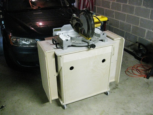The miter saw stand at its new home in front of my wife's car.