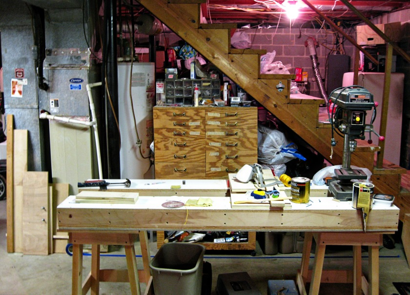 My tool cabinet, water heater and furnace behind my assembly table.