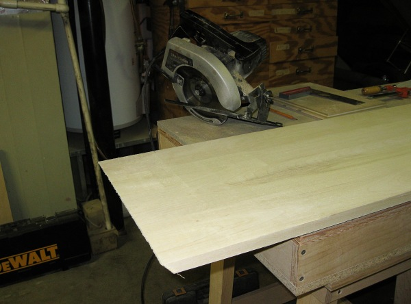 The easy cut. For this cut, I use a straight edge and set my circular saw to the right angle.