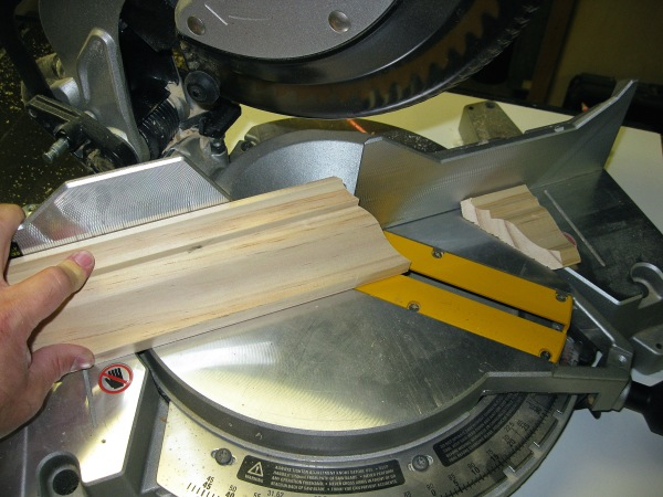 Mitered. I use my power miter saw to cut the crown molding. I don't use this saw very often because I have a hard time making the fine cuts to fit the molding properly. On these cuts where a 1/16″ or so is being cut, the saw is not accurate.