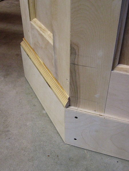 The baseboard is built-up from two pieces of trim.