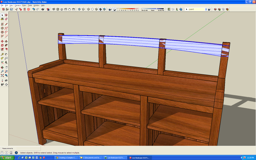 The crest rail in its final shape, but it is still one long rail, not three individual pieces.
