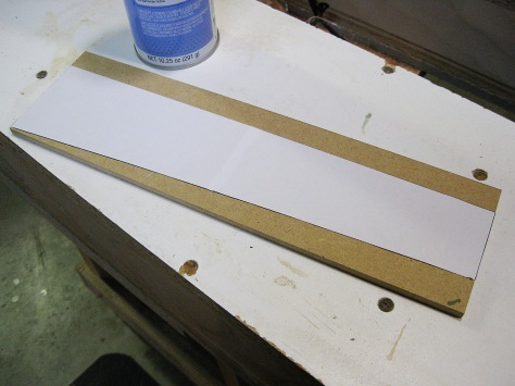 The printed shape of the lower left apron is glued to MDF.