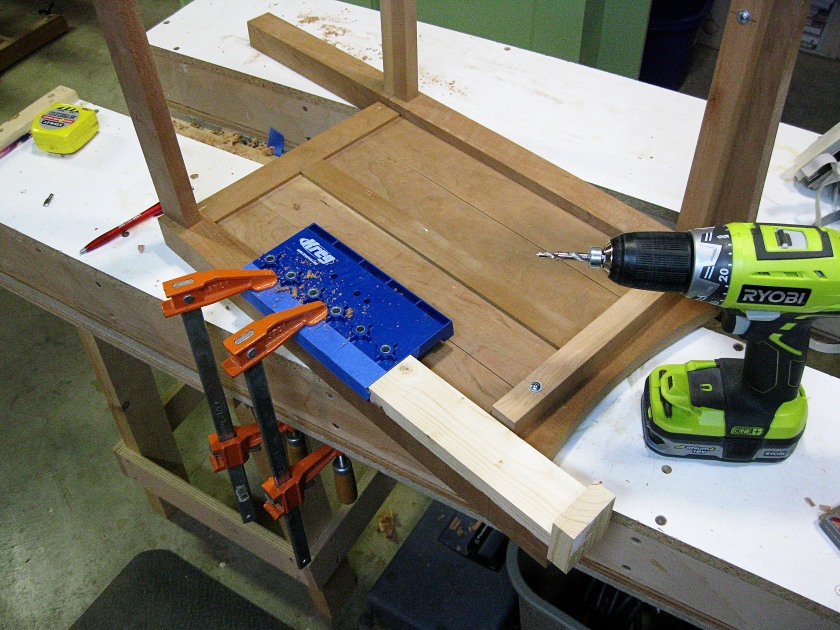 Adding adjustable shelf supports.