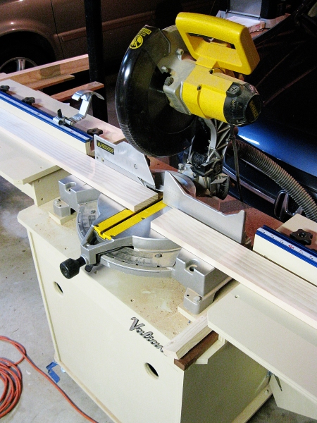 Using my miter saw station to break down long pine boards.