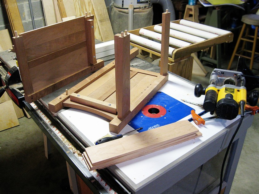 The right side bookcase disassembled on my router table and table saw.
