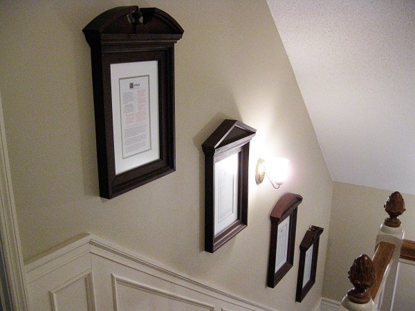 Pediment picture frames in the foyer.
