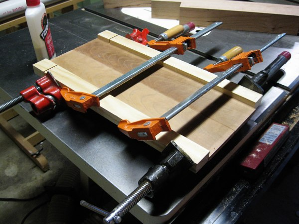 Simple glue-up. Pine boards keep the clamps from denting the cherry.