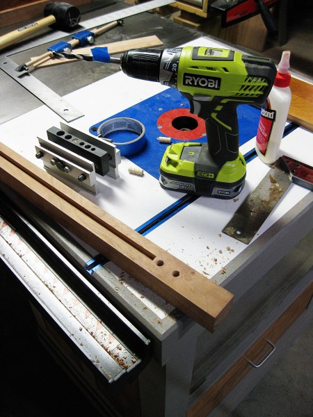 Using my dowel jig to create new holes.