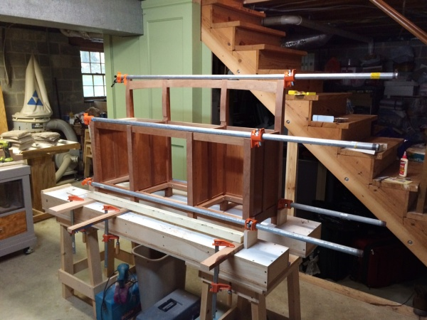 The glue-up bringing the left and right sections together.
