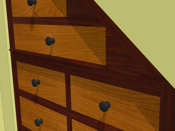 A close up shows a small molding detail at the base of the stair-stepped drawers.