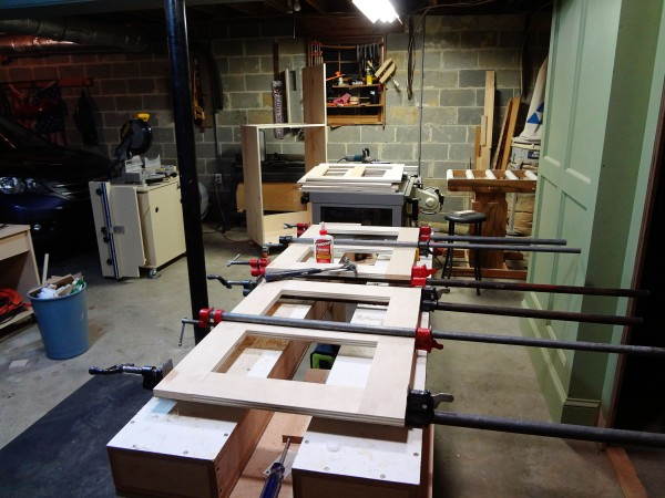 Four completed web frames on my router table; two still in clamps.