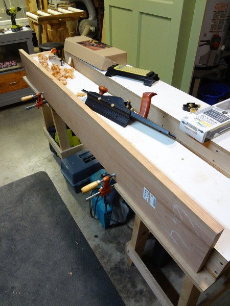 Jointing a straight edge on a cherry board.