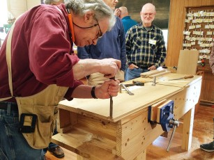 Chopping dovetail sockets in a case side.