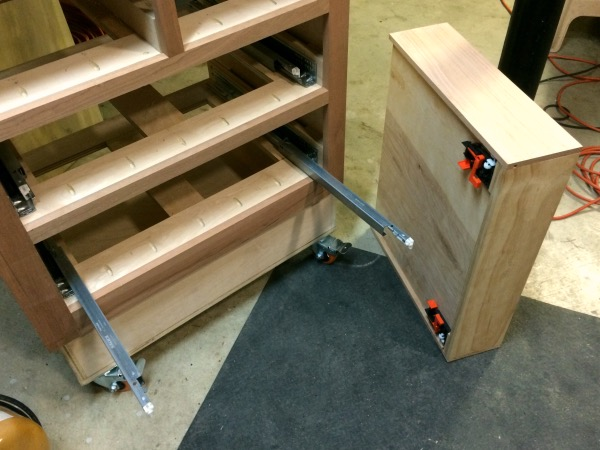 Getting ready to mount the drawer on the slides.