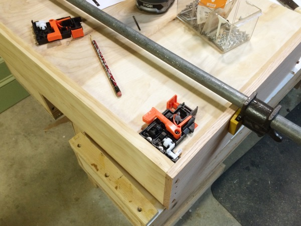Adding mounting clips to the drawer bottom.