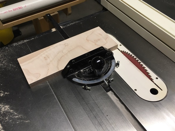 Using my table saw to trim a drawer edge.
