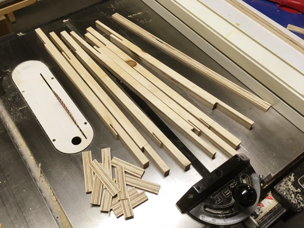 Upper drawer guides notched to fit into web frames.