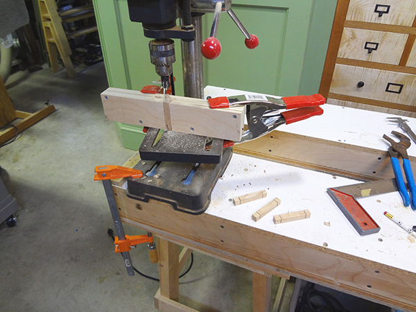 Drill press set-up for round tenons on square stock.